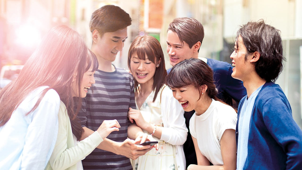Group of young people with smart phone; image used for at your service 24/7.