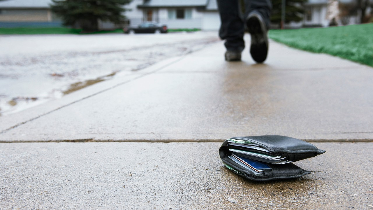 A lost wallet on sidewalk; image used for Lost or Stolen Cards.