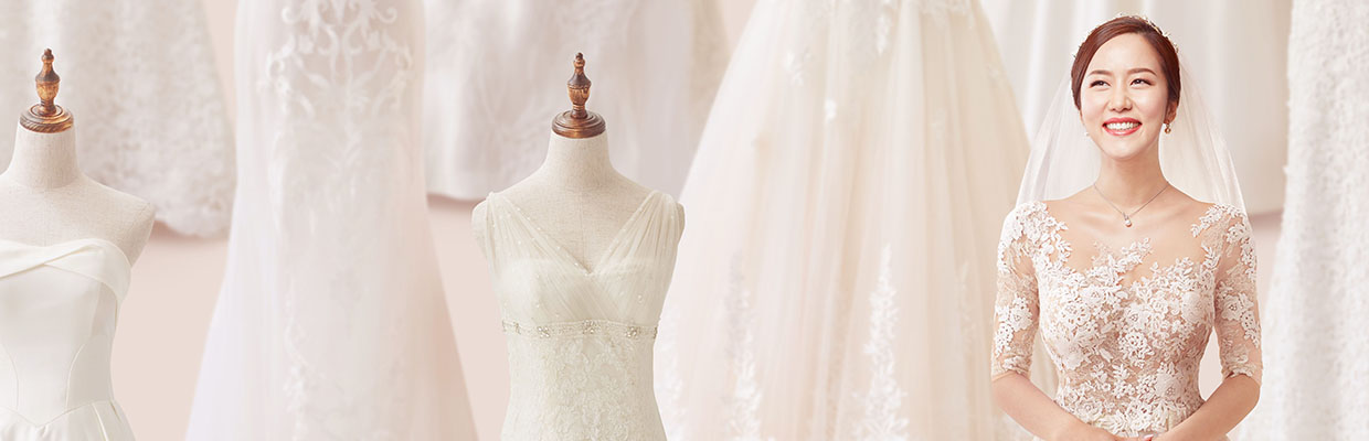 A woman standing next to mannequins in wedding gowns; image used for HSBC Personal Instalment Loan offer