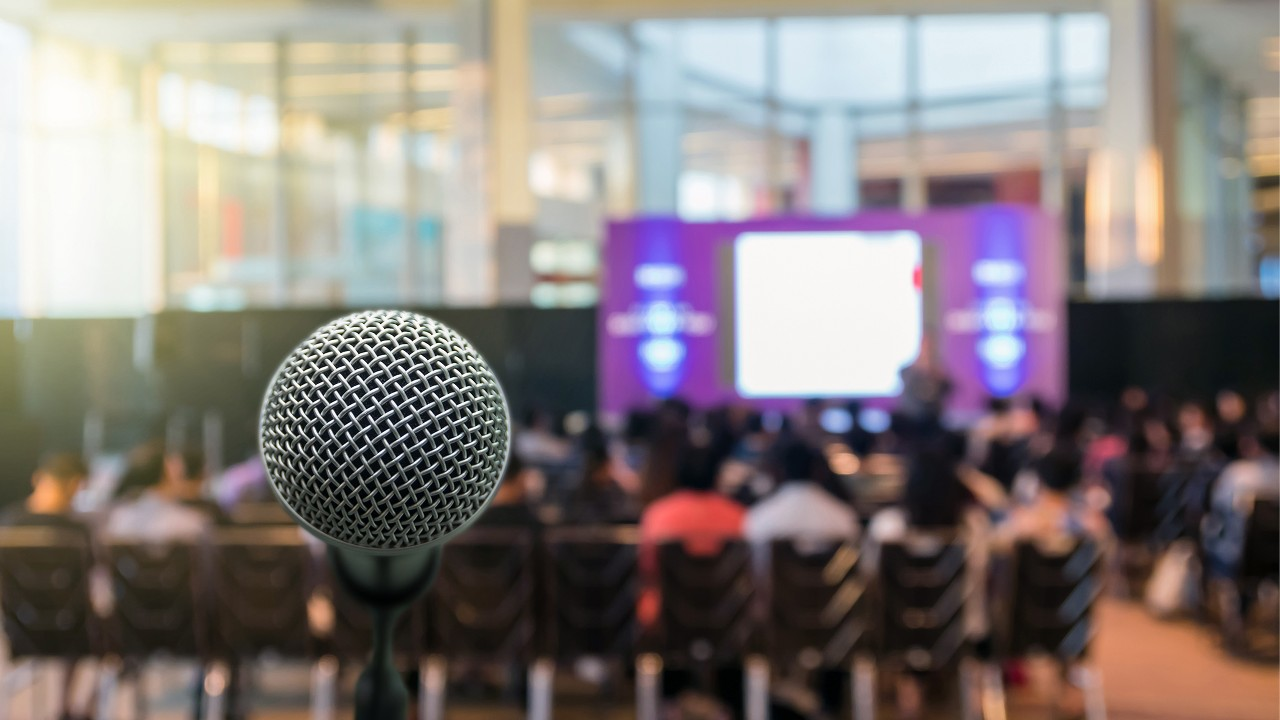 A microphone in a mall; image used for Talk of the market