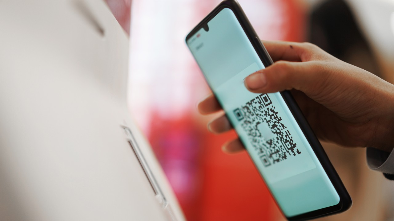 Scanning mobile QR code on the machine; image used for HSBC Credit Card.