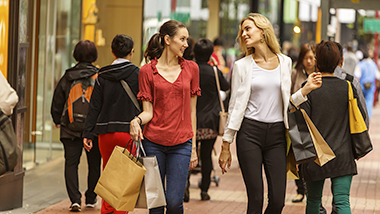 Two ladies have just finished shopping; image used for HSBC Reward Cash Program.