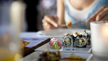 A woman is having Japanese meal; image used for Red Hot Offer Page.