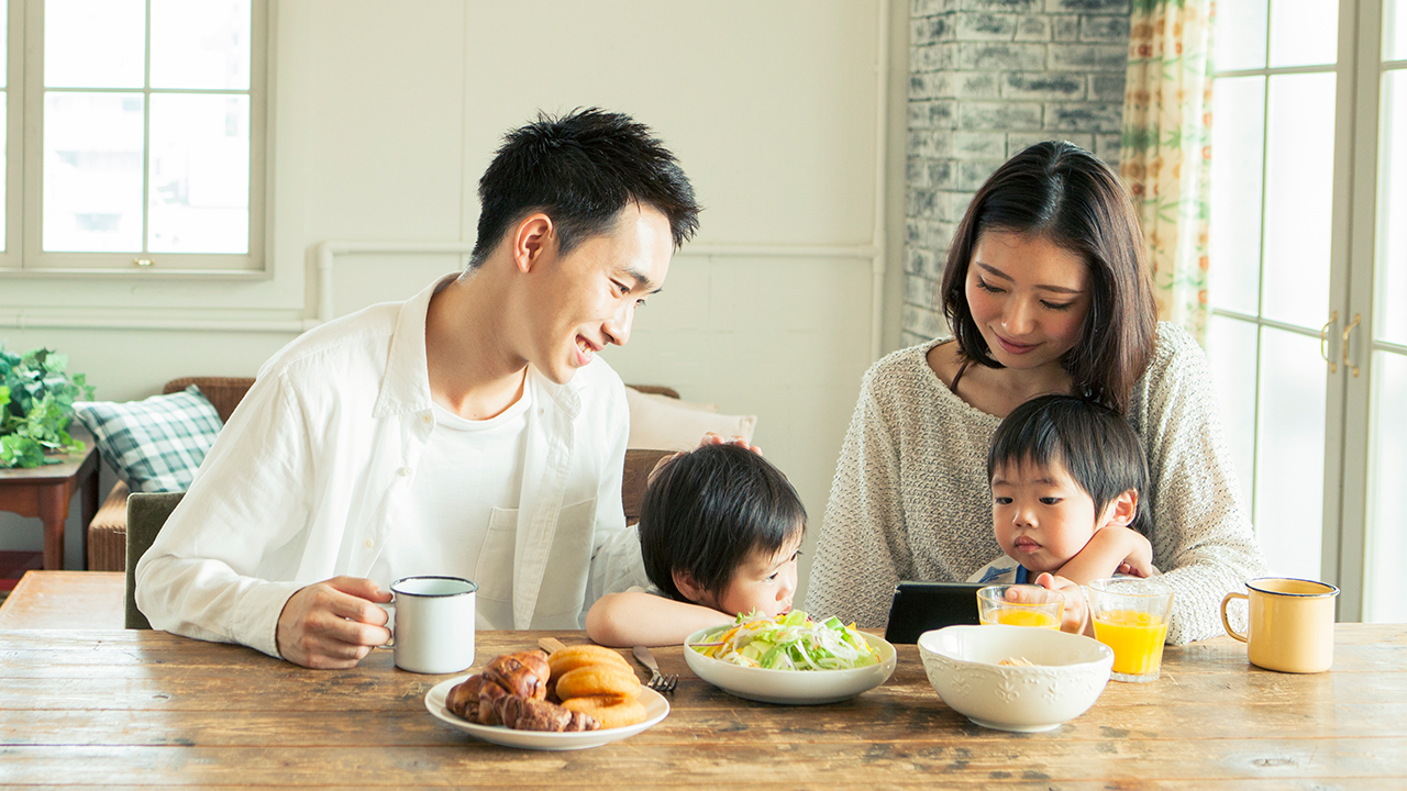 A family is having meal together; image used for Mortgage Protection Insurance.