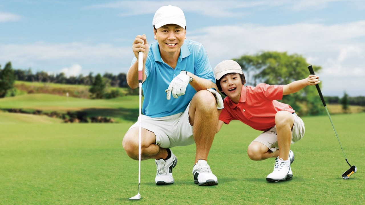 Father and son are playing golf; image used for HSBC Health Goal Insurance Plan.