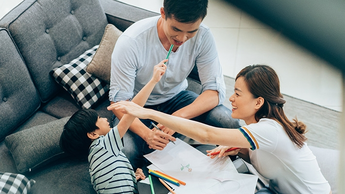 Family playing in sofa; image used for HSBC  Goal Access Universal Life Plan (Protection)