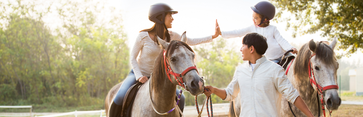 A family is riding horses; image used for HSBC Income Goal Insurance Plan page.