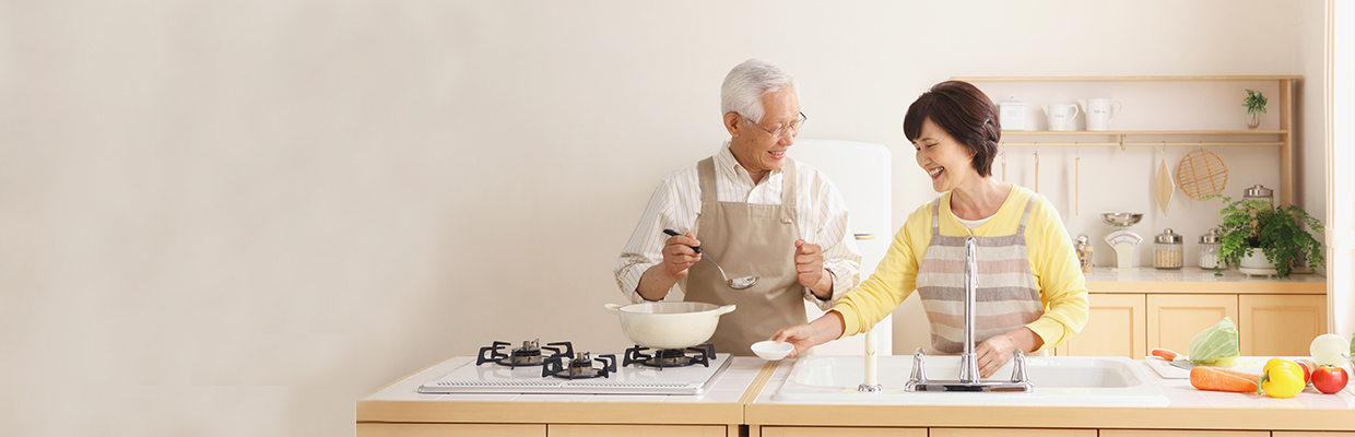 Old couple cooking ; image used for Fire Insurance.