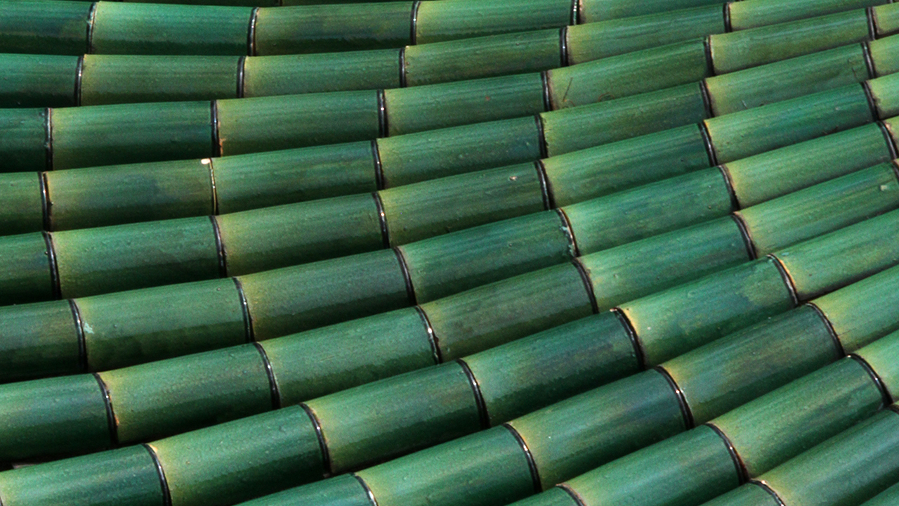 Emerald green roof tiles; image used for HSBC Jade Wealth Management Services.
