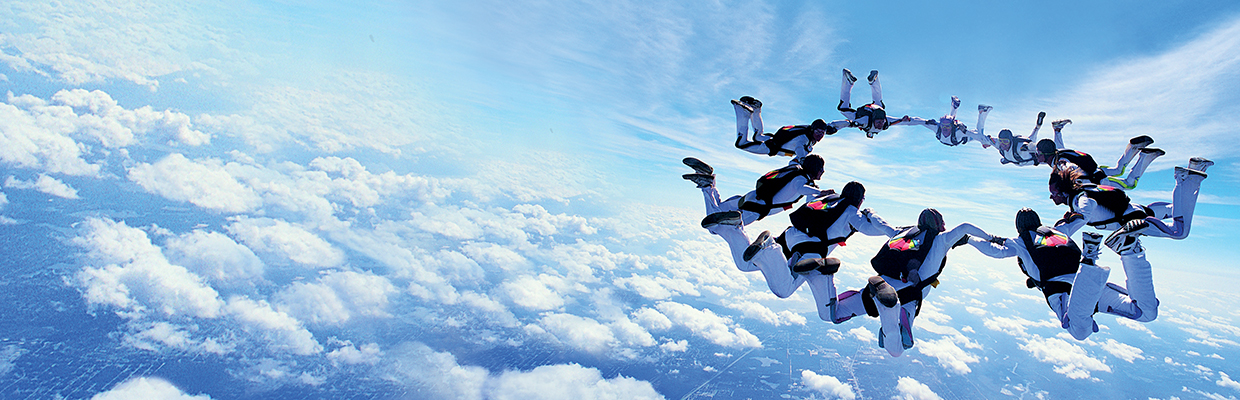 A group of people are skydiving.
