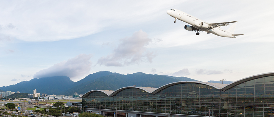Plane taking off at Hong Kong International Airport.