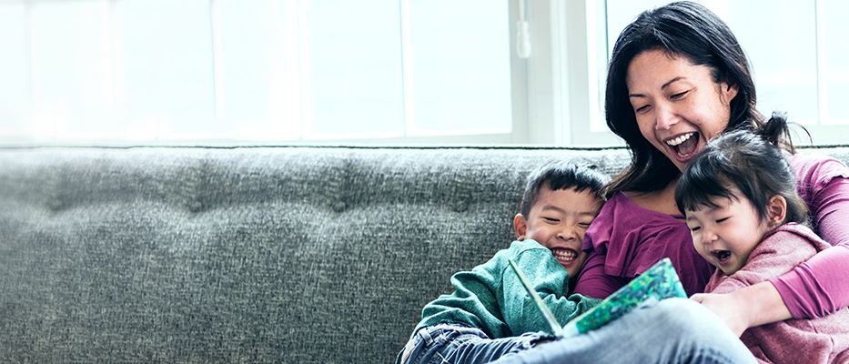Mother reading to young son and daughter; image used for HSBC Term Life Protector Insurance